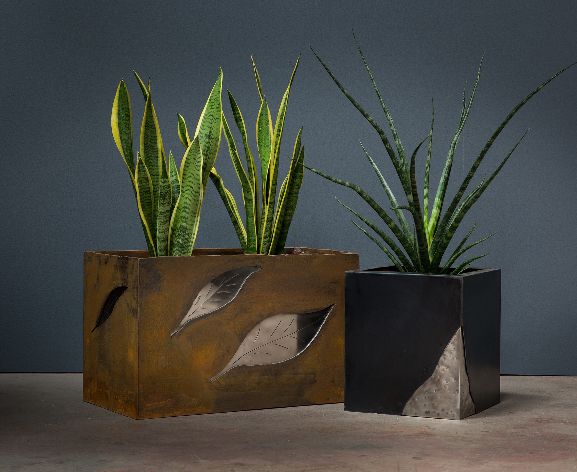 portfolio, planter boxes with mixed metals, coffee tables copper and steel legs, metal work, metalworker, interior design