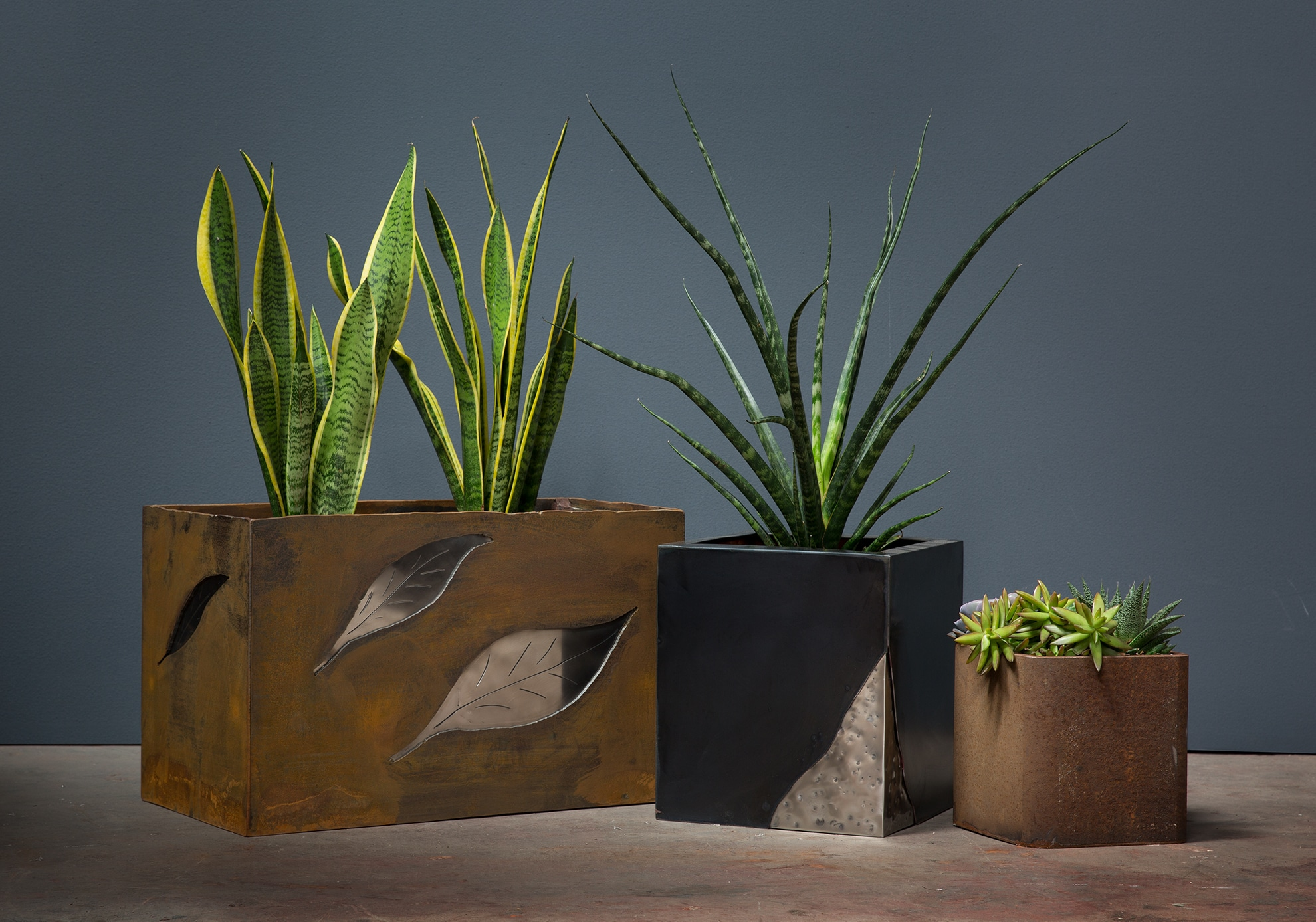 3 planter boxes with mixed metals
