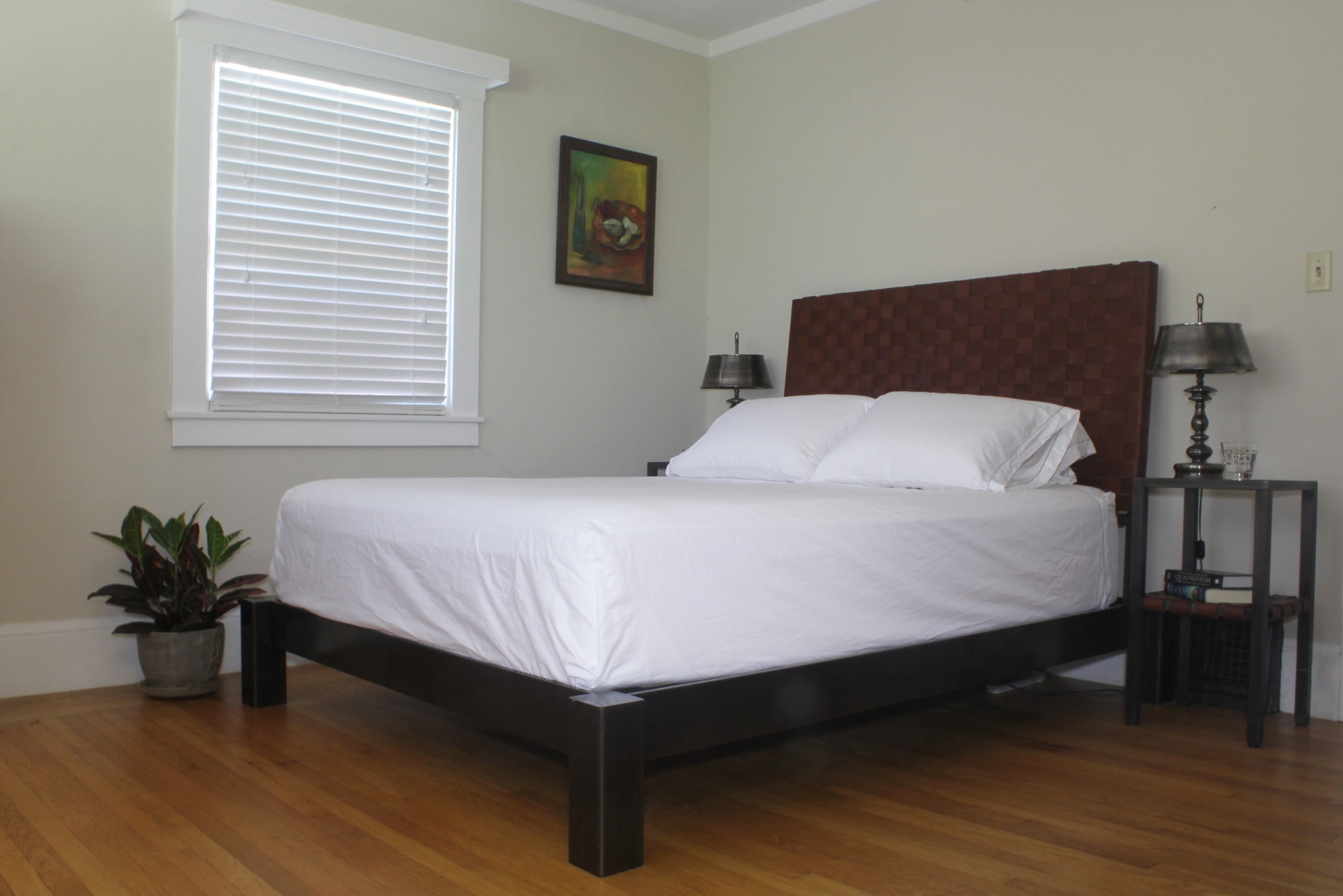 leather and steel bed with tables