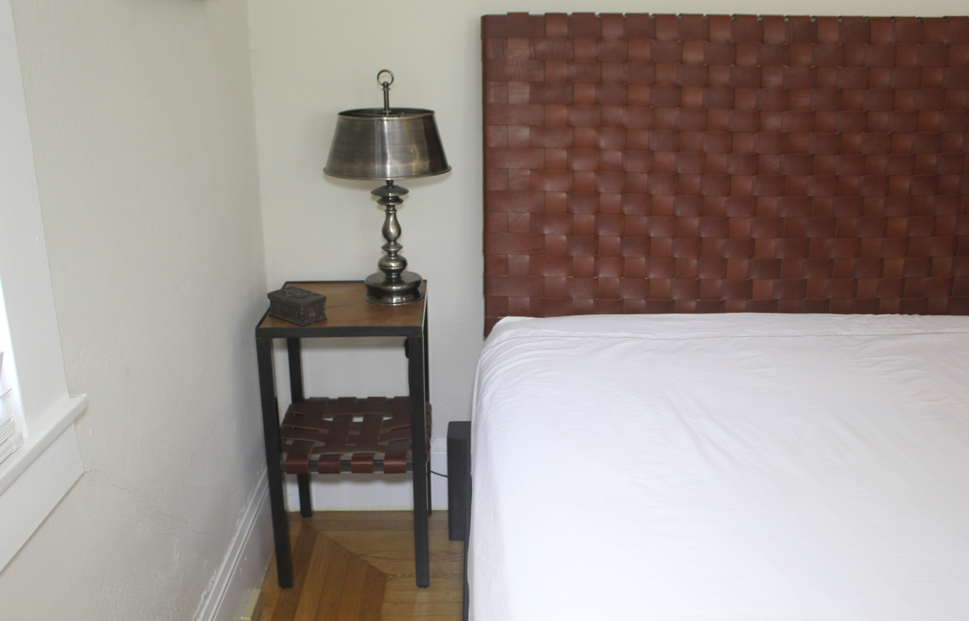 leather and steel bed frame with end table