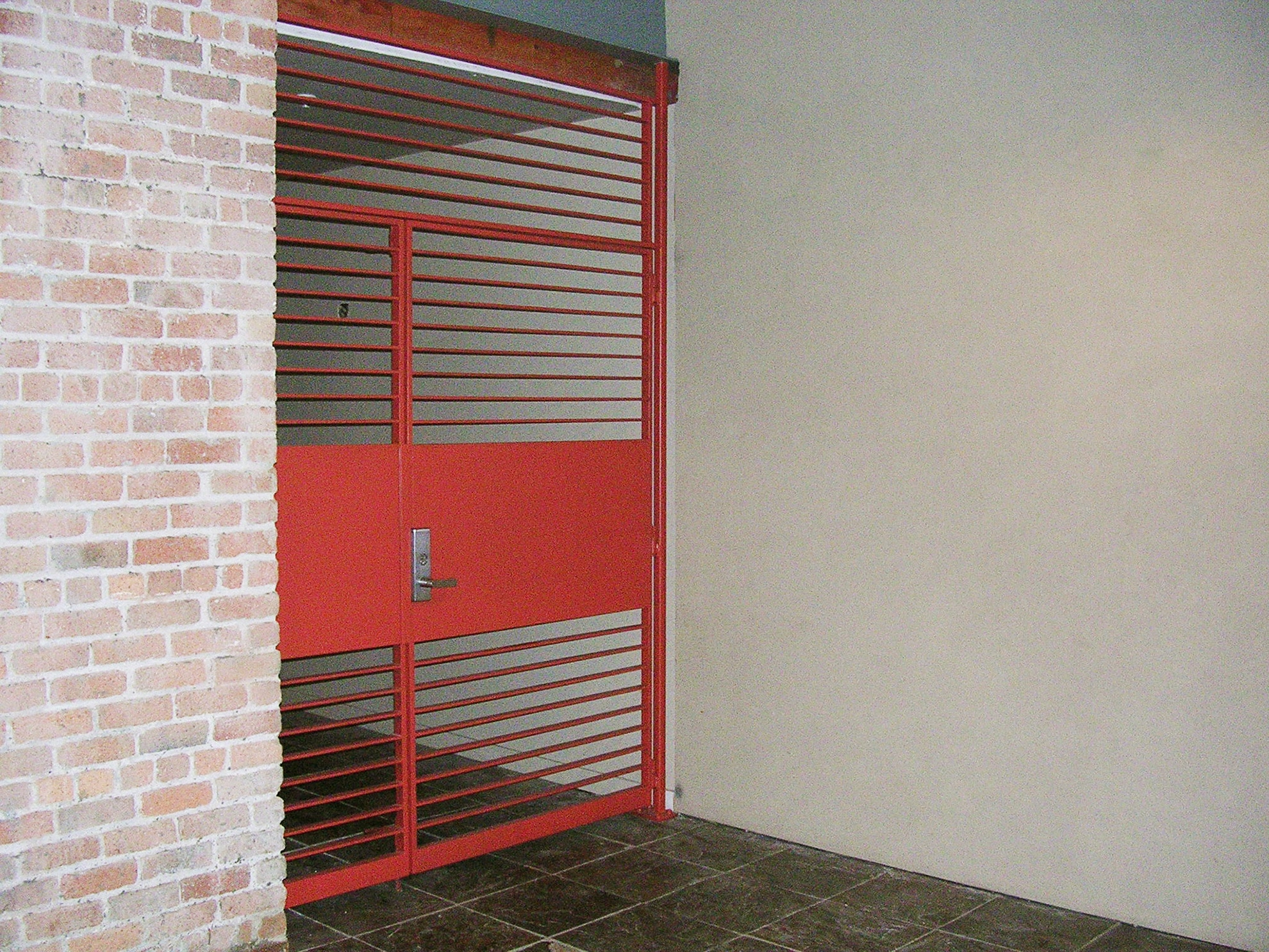 Red entry gate with horizontal bars and panel, metal gate, gate, metal fabrication, metalwork, metal work