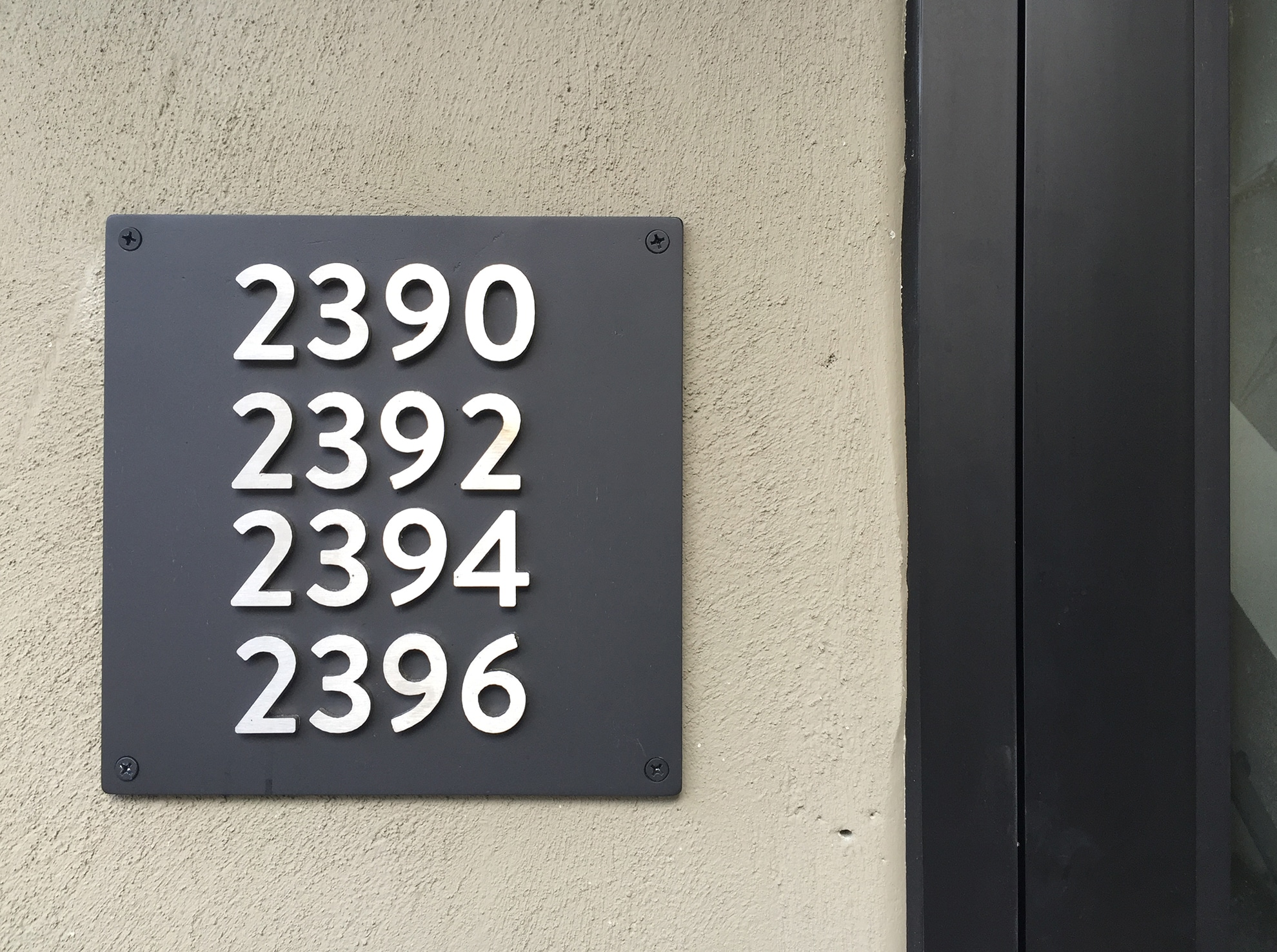 Metal signage with various apartment numbers