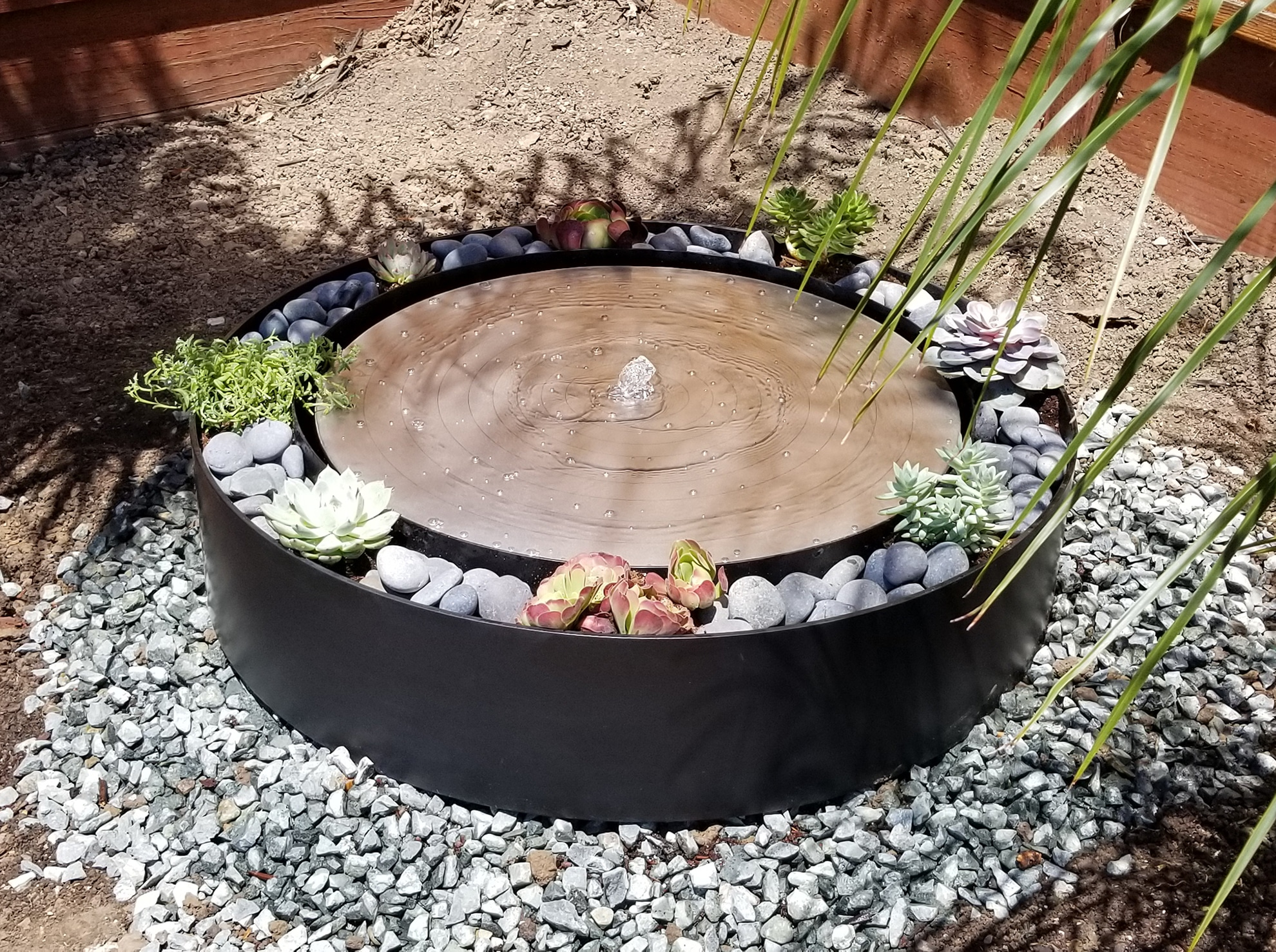 circular steel water fountain, outdoor, portfolio